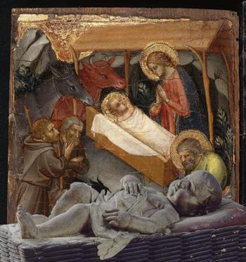 Montaje Natividad con el buey y la mula y el niño en soledad.